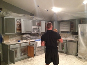 We started by priming the cabinets.